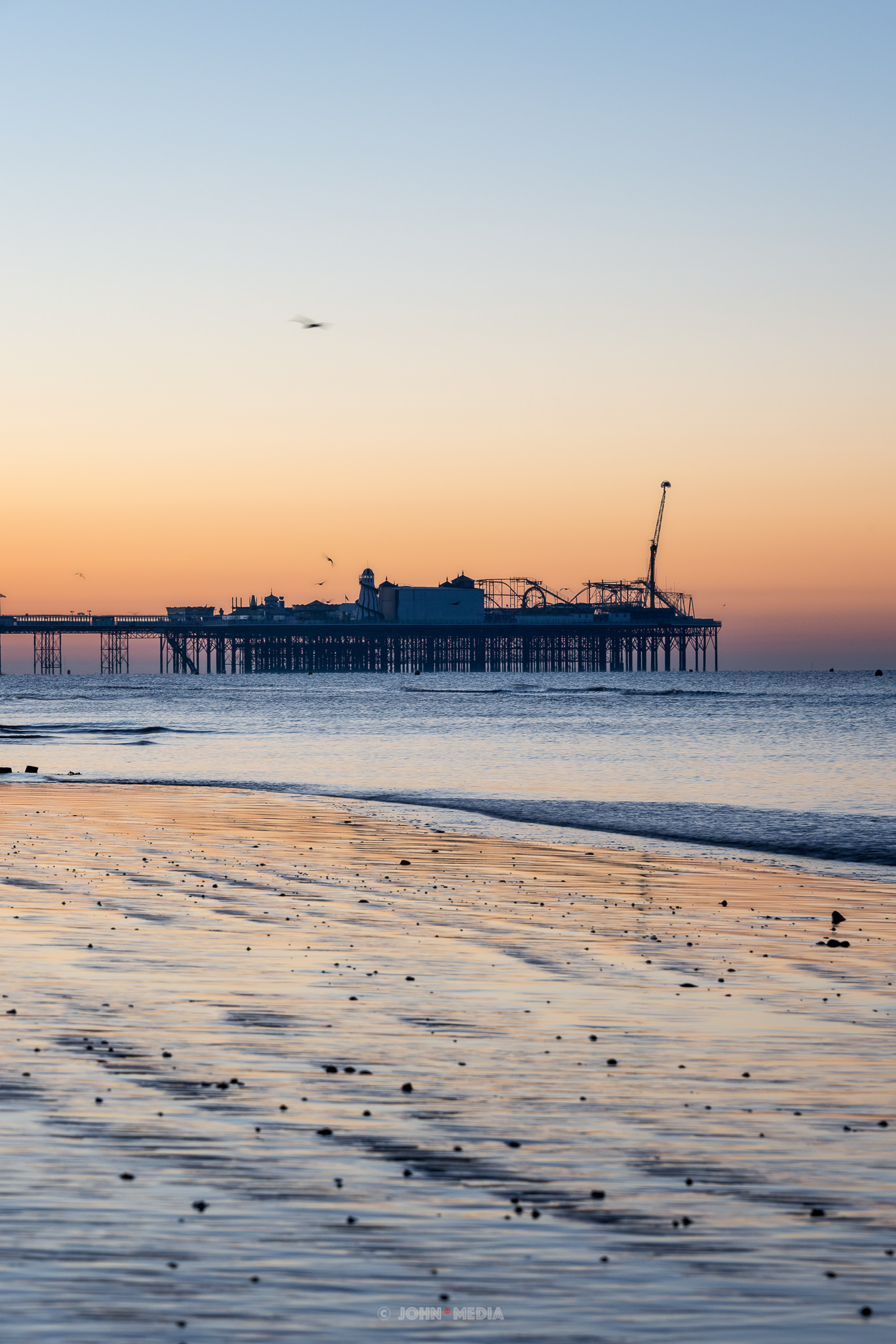 Brighton Palace Pier sunrise in the distance