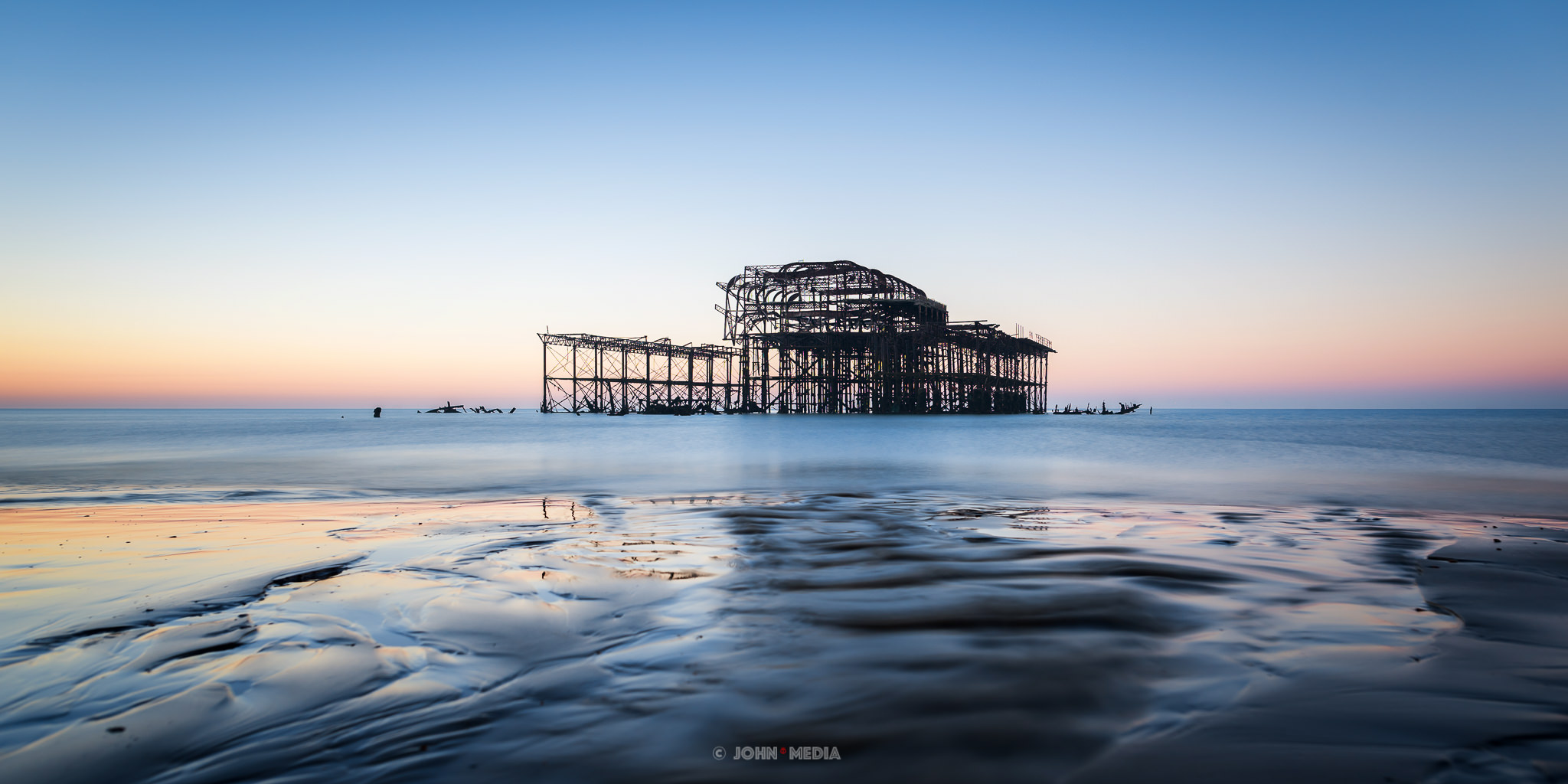 Slow sunrise at the west pier