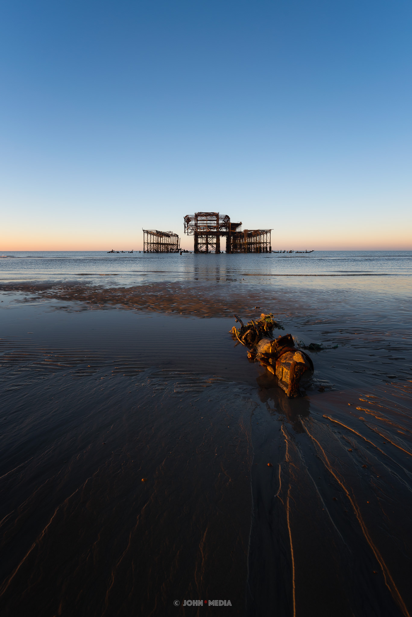 Brighton West Pier sunrise low tide