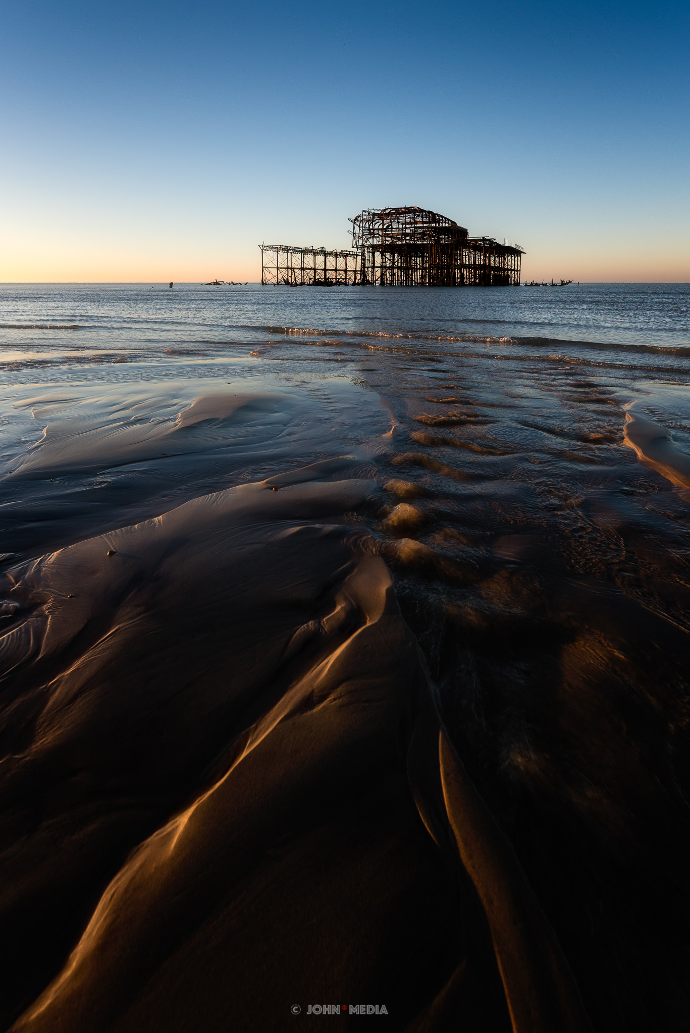 Brighton West Pier sunrise low down